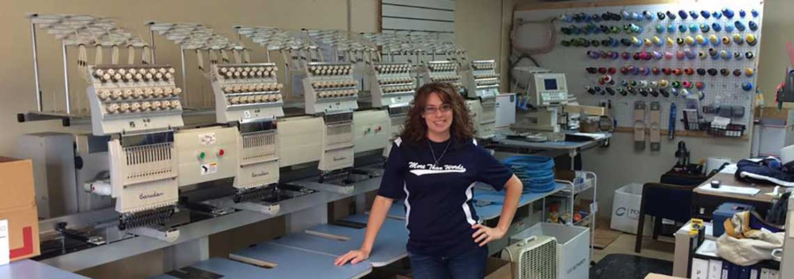 Jamie with custom embroidery machines
