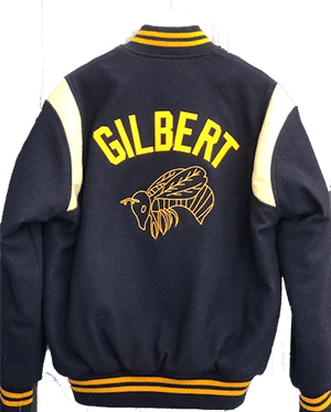 The Gilbert School varsity jacket in navy and gold