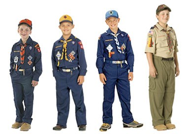 Four boys dressed in Boy Scouts uniforms